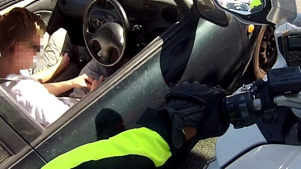 Article image for Police catch driver rolling joint