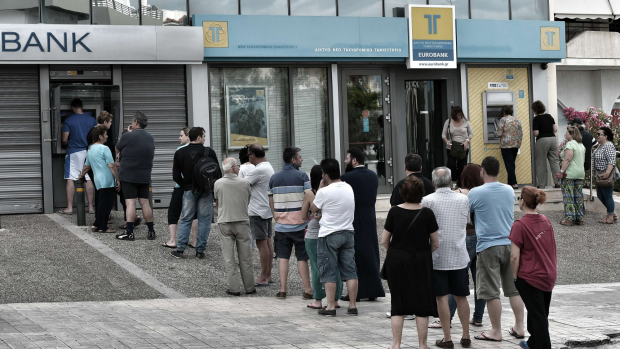 Article image for Greece limits ATM withdrawals to 60-euros