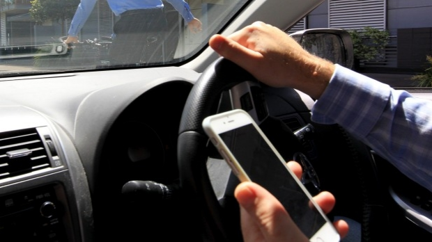 Article image for Lifetime ban for texting driver: Professor