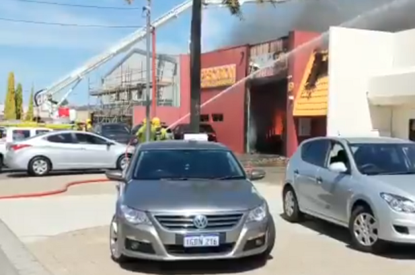 Man burned from 'waist up' in auto shop fire