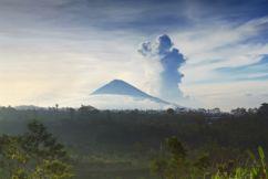 What makes a dormant volcano erupt?