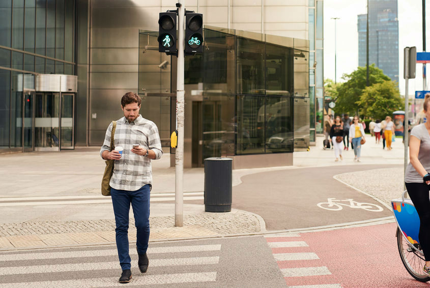 Pedestrian fines for texting while crossing a road
