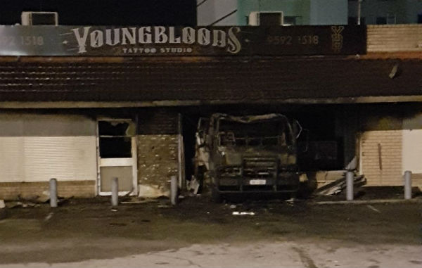 Article image for Truck crash at tattoo parlour causes fire