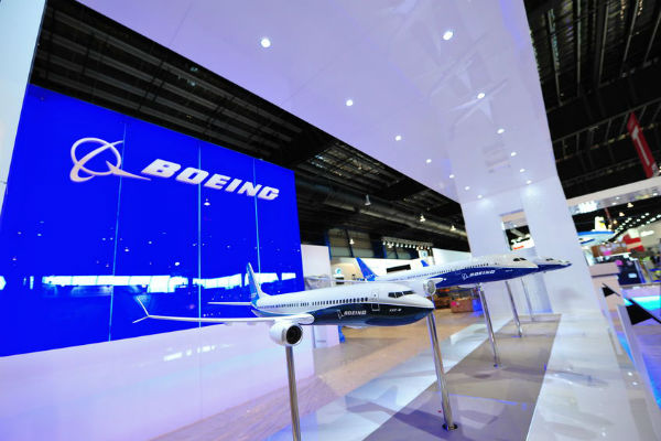 Boeing cuts production and stocks fall.