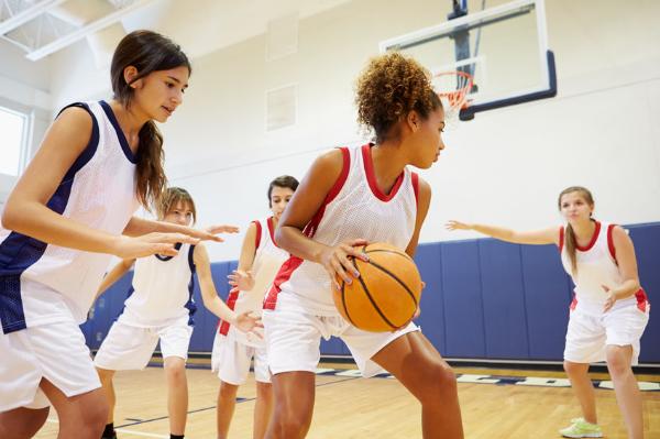 Teenage girls walking away from sport