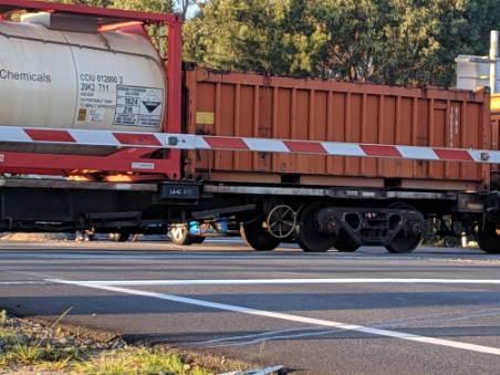 Cargo train crashes into car