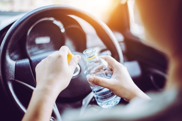 Can you get fined for drinking WATER while driving?