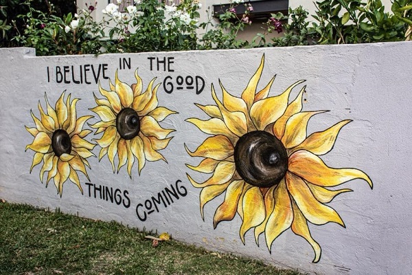 Article image for 'The Sunflower Girl' painting Perth and spreading brightness one mural at a time