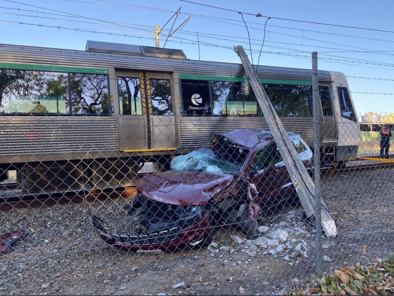 Article image for Commuter chaos after train hits abandoned car on tracks