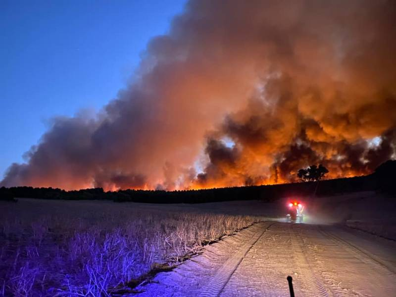 Article image for Firefighters brace for difficult conditions as fires rage across the state