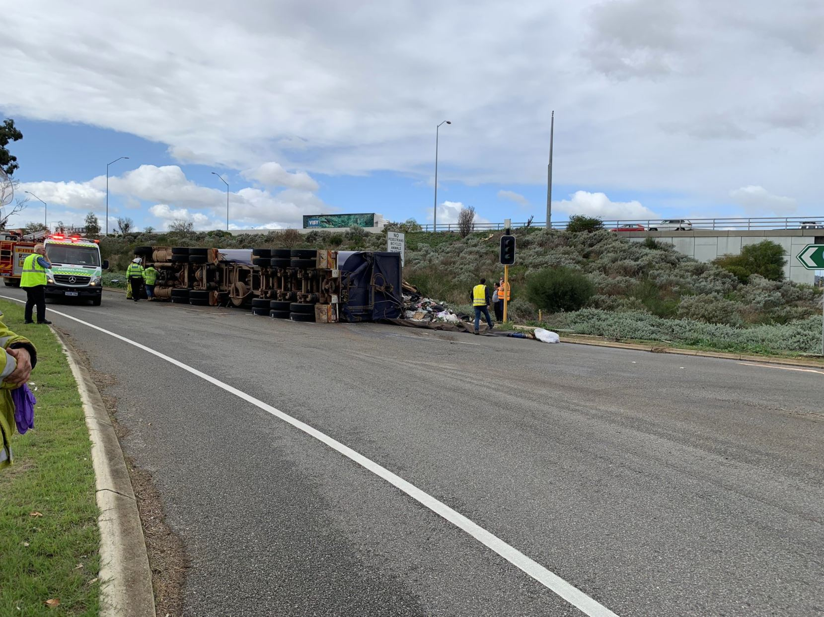 Article image for Rubbish truck loses load on Perth highway causing traffic chaos
