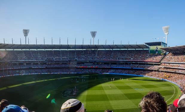 Suns boss takes swipe at Victoria in bid to move AFL Grand Final