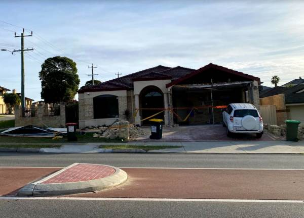 Article image for Car ploughs into northern suburbs home after two car crash