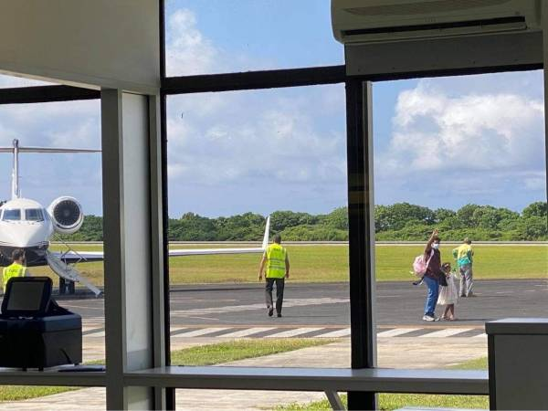 Flight lands – Tamil family reunited