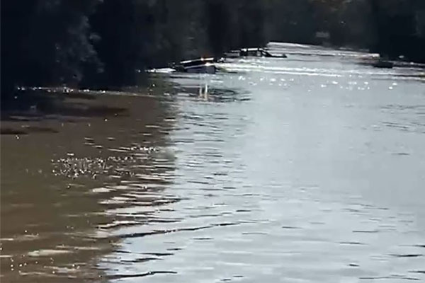 Search scaled back for man missing in floodwaters