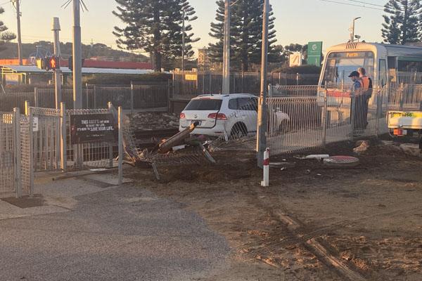 Article image for Crashed car abandoned on Fremantle train line causes 'major delays'