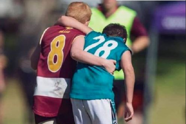 Article image for Heroic act of sportsmanship at junior footy grand final